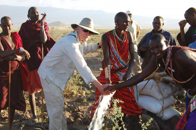 shaking hands with Maasai leader
