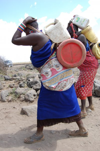 women hauling water home