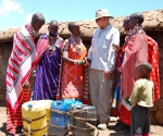 women thank Global Water for well