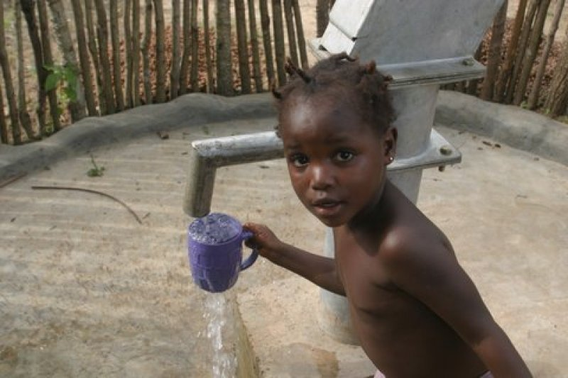 girl and water from well