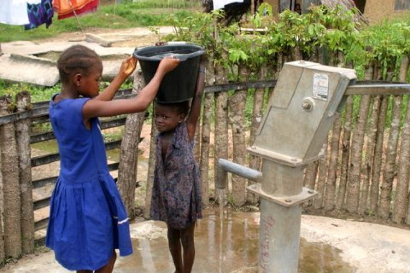 sisters helping to carry water