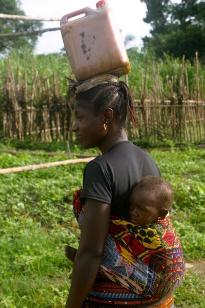 Mother carrying water on head