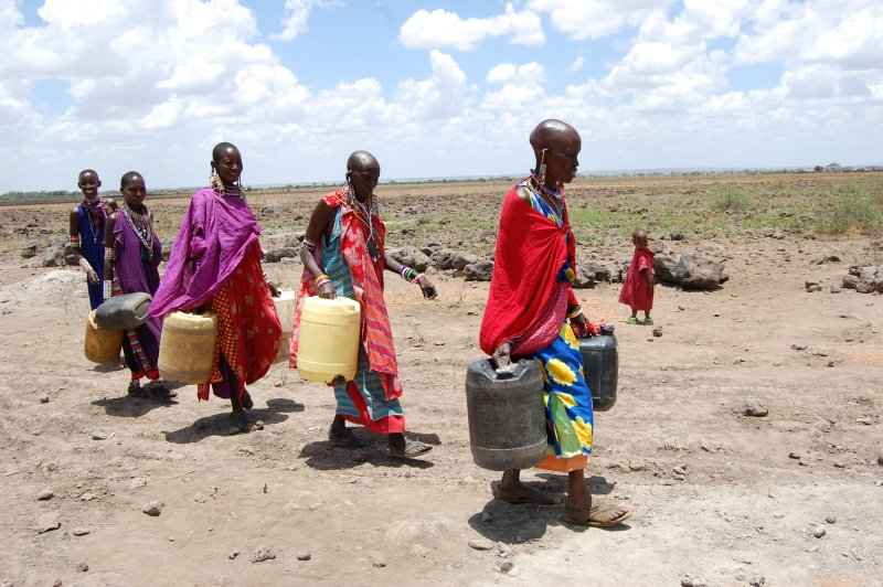 Women carrying water, Kenya
